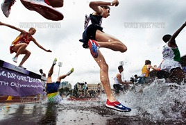 SINGAPORE - AUGUST 18:  Ioran Etchechury of Brazil trips and falls head first into the water  hazard during the Boys 2000m Steeplechase on day four of the Youth Olympics at Bishan Stadium on August 18, 2010 in Singapore. (Photo by Adam Pretty/Getty Images)